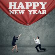 two business person drag new year banner - stock illustration