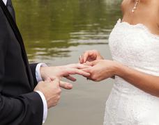 wedding couple are swearing lifetime loyality - stock photo