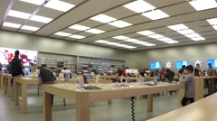Time lapse of people buying new iphone inside apple store Stock Footage