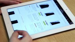 Woman shopping new computer of futureshop website on ipad display Stock Footage