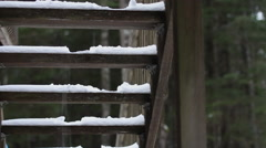 Man Walks Down Snowy Stairs Exits Left Stock Footage