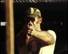 Men Firing Guns at Gun Range (Archive Footage) 1980s - stock footage