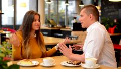 unhappy couple argue in cafe - coffee and cake - stock footage