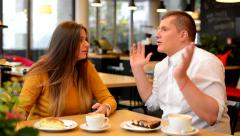 Unhappy couple argue in cafe - woman leave man - coffee and cake Stock Footage