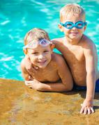 two young boys having fun at the pool - stock photo