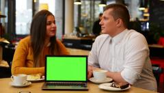 Happy couple talk in cafe - coffee and cake - computer (notebook) green screen Stock Footage