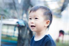 little asian boy play at playground - stock photo