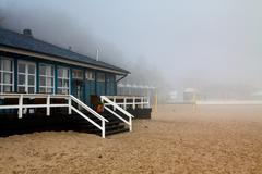 beach house in fog with balustrade and stairs - stock photo