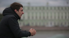 Sad man standing on the bridge in the center of St. Petersburg Stock Footage