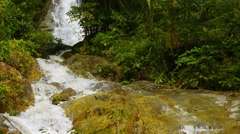 Whitewater cascading over a natural waterfall in thailand, with sound Stock Footage
