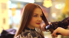 Alignment hair to young beautiful redhead model girl on the eve of the party - stock footage