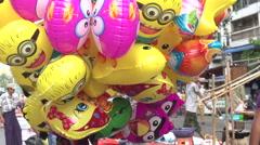 Yangon, boy with balloons at street fair Stock Footage