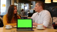 computer (notebook) green screen - happy couple smiles to camera in cafe -coffee - stock footage