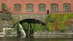 Waterfall Runs Under Building in Spokane Stock Footage