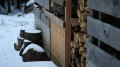 Woodshed full of firewood Tilt Up to Alaskan Sky Stock Footage