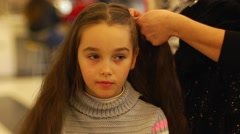Making hairstyle for little girl before party Stock Footage