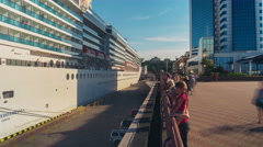 4K. Panning timelapse of white luxury cruise liner Costa Mediterranea undock Stock Footage