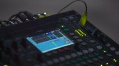 Music studio audio mixer with digital VU meter display showing audio waves. Stock Footage