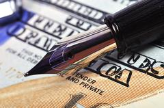 Nib pen and dollar Stock Photos