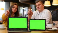 computer (notebook) and tablet green screen - happy couple smiles to camera - stock footage