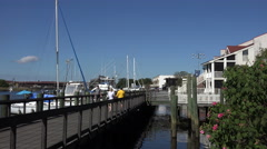 People walk along the georgetown harborwalk, sc, usa Stock Footage