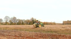 Deepening channels in wet field. Tractor with cutter is working in farmland. Stock Footage