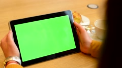 Woman works on tablet green screen in cafe - coffee and cake Stock Footage