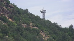 Communication Tower On Forest Hillside Mountain Dramatic Handheld 4K Stock Footage