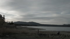 Big Bear Lake, timelapse with tourist on shore, clouds Stock Footage