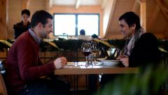 Happy couple in the restaurant (interior) - waiter serves up food to customers Stock Footage