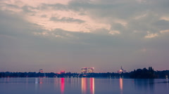 Timelapse day to night over lake reflecting dusk holy grail sunset Stock Footage