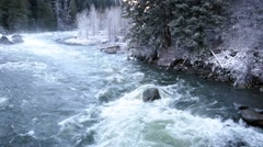 Rapid river in a snow covered forest Stock Footage