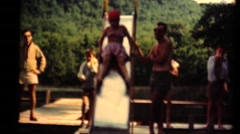 Middle America ,1949, Swimming slide at lake Stock Footage