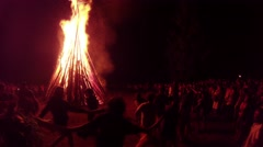 dance around the great fire during the celebration of the pagan holiday - stock footage