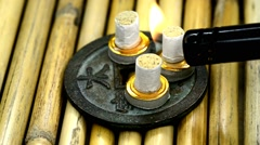 Chinese medicine, burning moxibustion cones Stock Footage