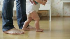 Baby girl ( 1 year old ) walking his first steps, dolly shot - stock footage