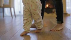 Baby girl ( 1 year old ) walking his first steps, dolly shot Stock Footage