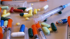 Medicine, multicolored pills and capsules close up, dolly. Stock Footage