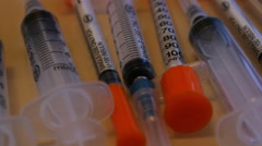 Medicine concept, multicolored syringes close up, dolly. Stock Footage