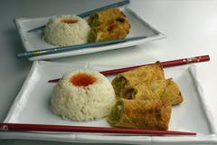 egg rolls with rice - stock photo