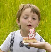 one kid at three years anniversary in nature - stock photo