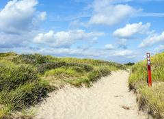 Way through the dunes on the island of fanoe in denmark Stock Photos