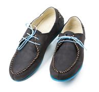 black men's leather loafers with blue soles and laces on a white - stock photo