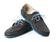 Black men's leather loafers with blue soles and laces on a white Stock Photos