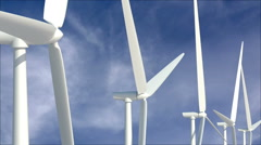 Stock Video Footage of Wind turbines against cloudscape
