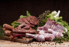 Fresh butcher cut meat assortment Stock Photos