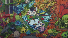 graffiti, gambling fish - stock footage