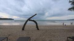 Log Wood Sculpture Tropical Sandy Tourist Beach Island Sea Waves Ocean Clouds Stock Footage