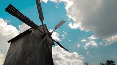 Wooden windmill with time lapse clouds in the sky. - stock footage