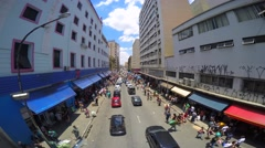 Time Lapse of Hundreds of People walk along the 25 March area in Sao Paulo Stock Footage